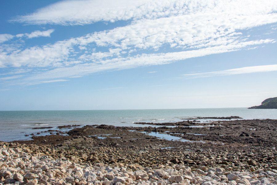 The rocky beach along the coast of Howth, Ireland.