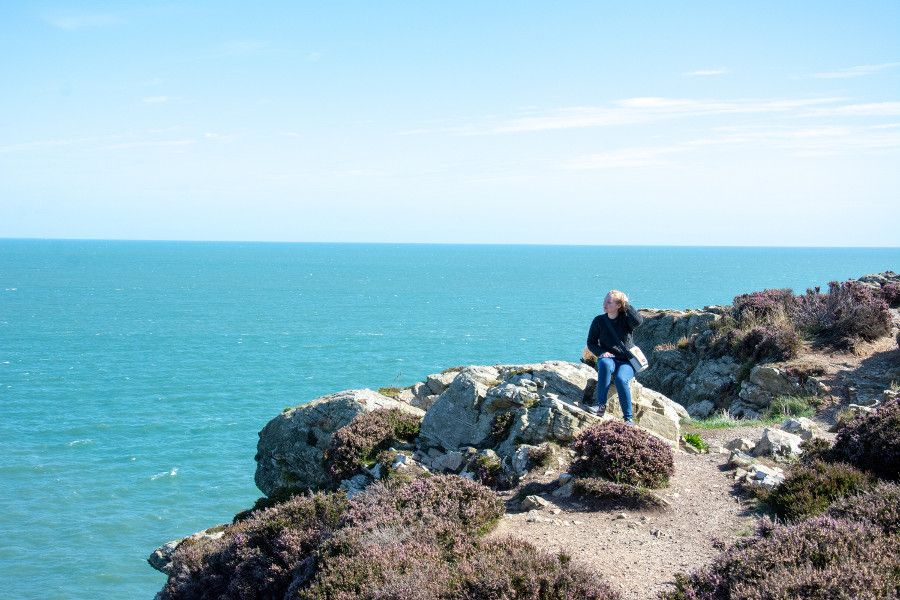 Sitting on the edge of the Howth cliff.