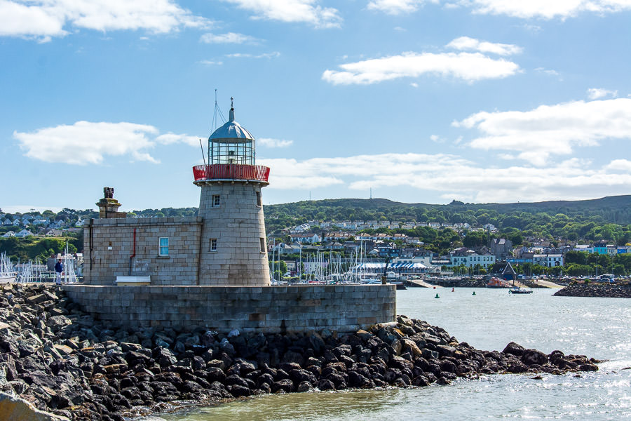 The Howth Lighthouse sits at the far point of the harbour area, jutting into the bay.