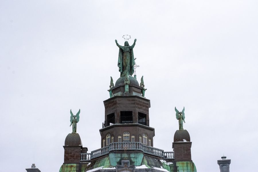 Sculptures line the top of the Notre-Dame-de-Bons-Secours Chapel in historic Old Montreal.