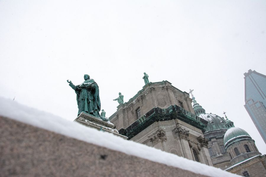 A view of the sculptures atop the Mary, Queen of the World Cathedral through the snow in Montreal, Canada.