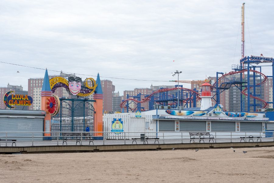 Coney Island attractions and boardwalk in winter.