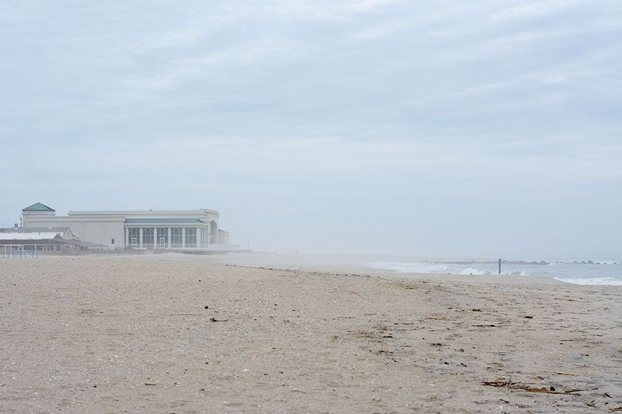 The Cape May Convention Hall in the distance on the empty winter beach.