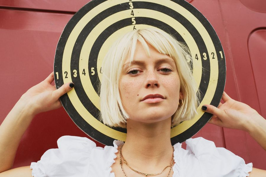 Learn and practice the German language using music in German! This month features the music of alt pop singer Alli Neumann!