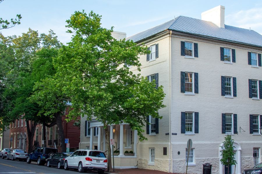 A block of white painted buildings on Cameron Street in Old Town Alexandria.