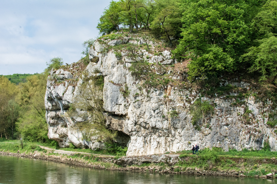 Hikers walk along the Danube River Gorge, or Donaudurchbruch.
