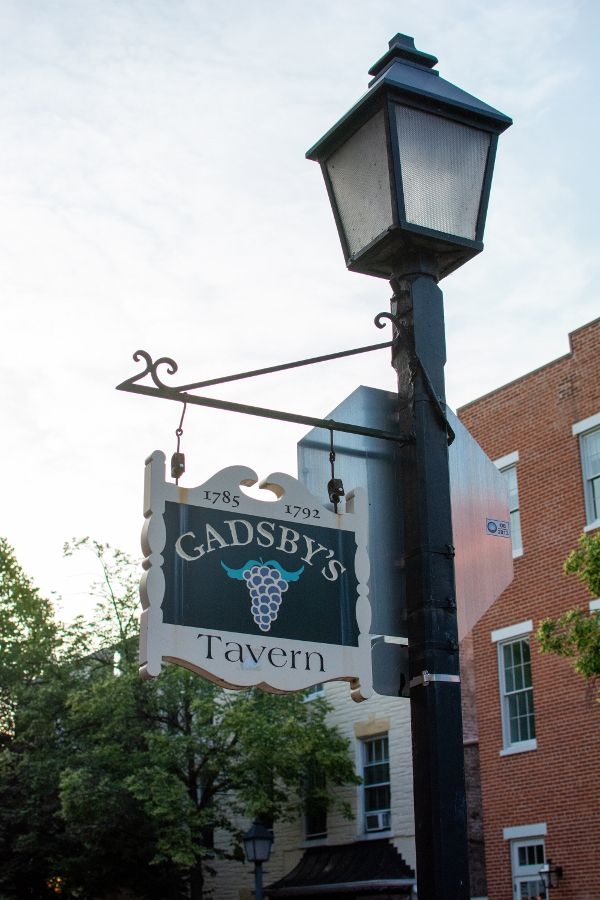 A sign post outside of Gadsby's Tavern in Old Town Alexandria.