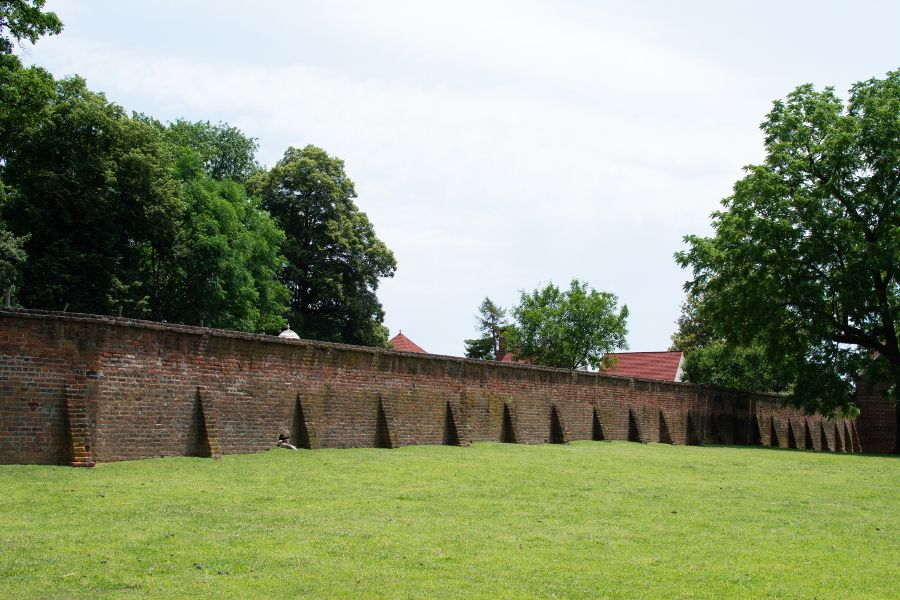 A brick wall across a field at George Washington's Mount Vernon.