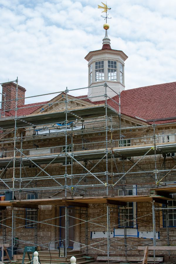 Scaffolding covers the front of the mansion at Mount Vernon.
