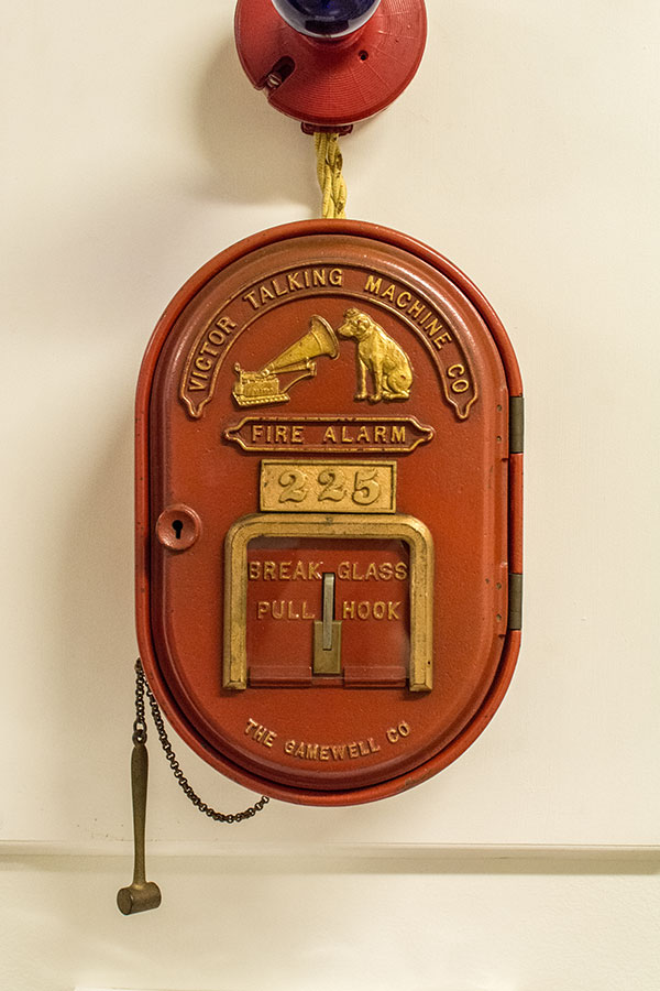A fire alarm featuring the Victor Talking Machine Company logo at the Johnson Victrola Museum.