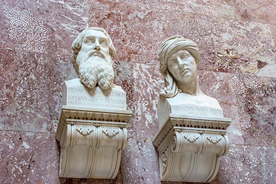 A close up of busts honoring Johann von Guttenberg and Johann van Eyk.