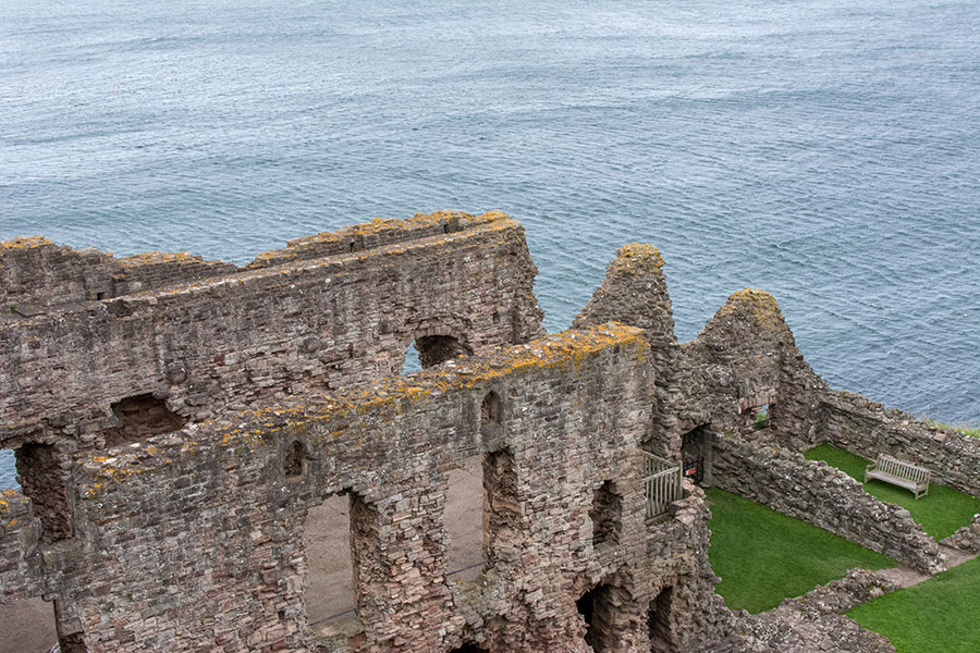 The ruins of Tantallon Castle sit along the sea.
