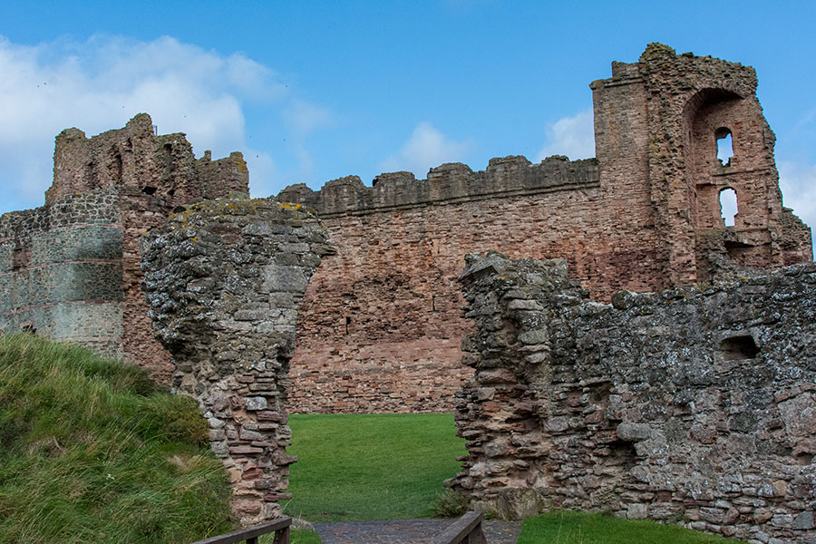 A walkway draws visitors into the ruins of Tantallon Castle.
