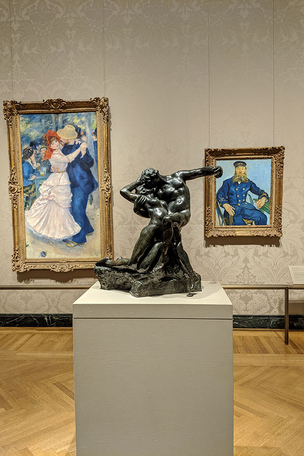 Impressionist works of art, including Vincent van Gogh, hang on the walls inside the Museum of Fine Arts, Boston.