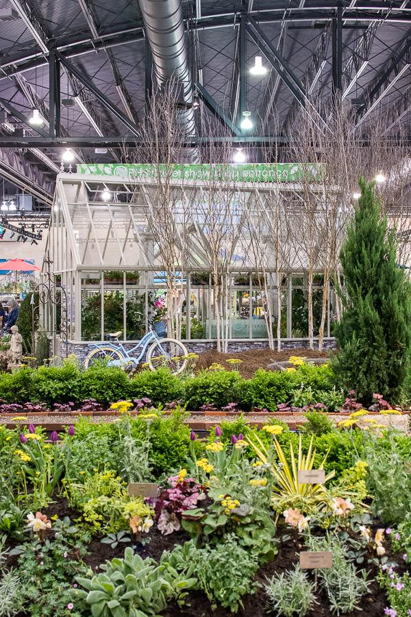 A greenhouse set amongst the plants.
