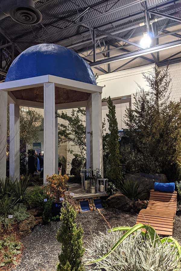 A Mediterranean inspired backyard landscaping exhibit at the Flower Show.