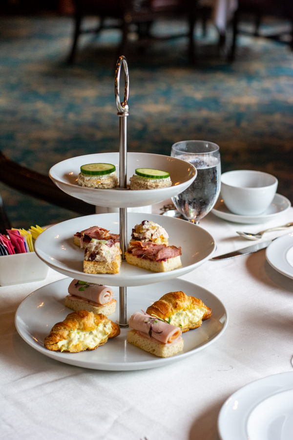 Three tiers of tea sandwiches at the Hotel DuPont afternoon tea.