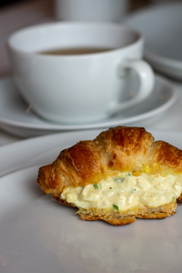 On the menu at the Hotel DuPont afternoon tea is a truffle egg salad croissant sandwich.