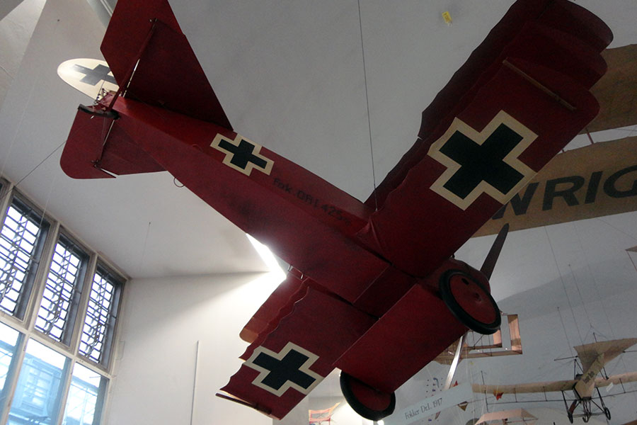The Red Baron's airplane hangs from the ceiling of the Deutsches Museum.