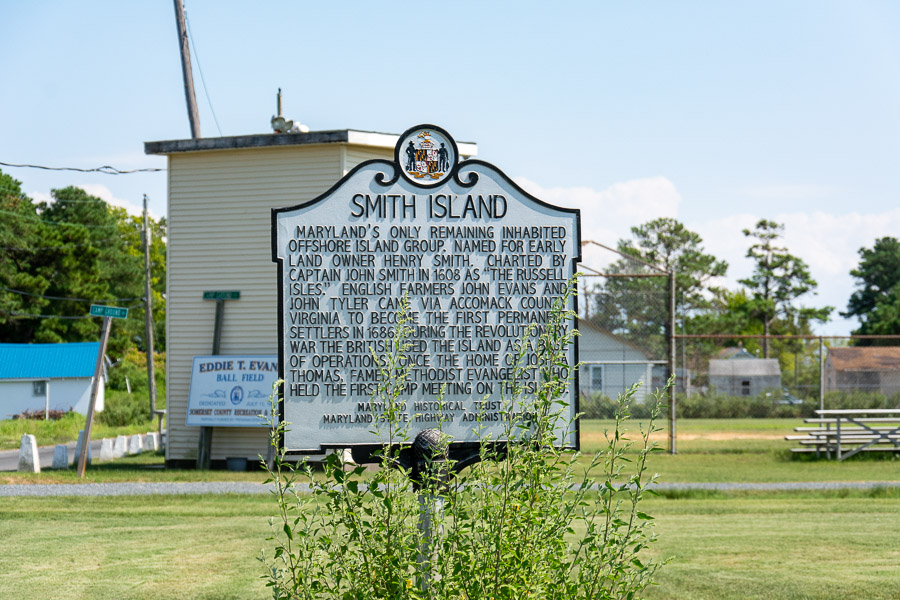 A metal sign explains the history of Smith Island.