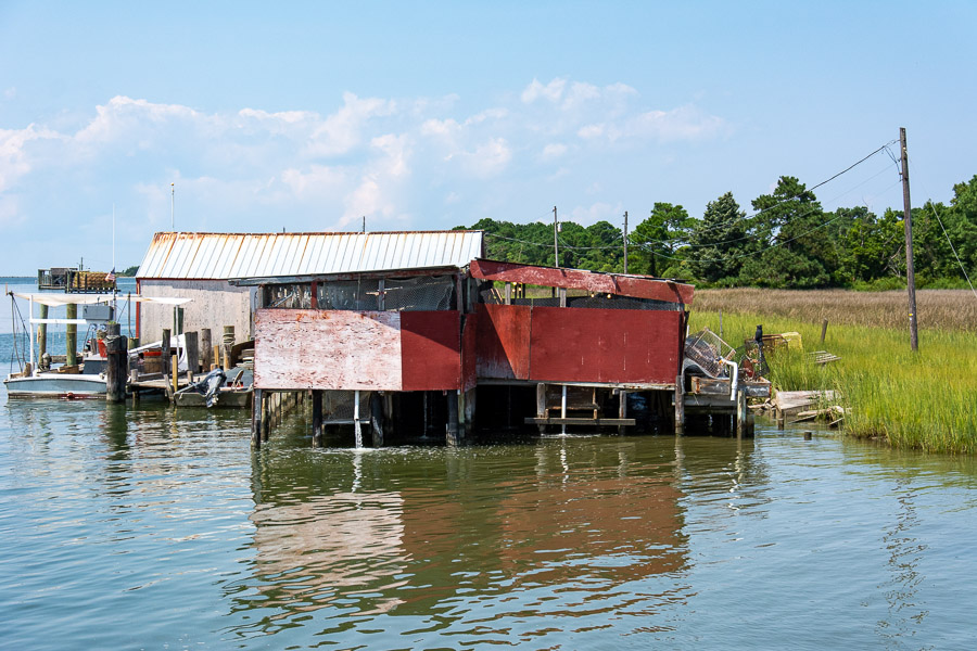 Buildings on stilts just above the water of the Chesapeake Bay.