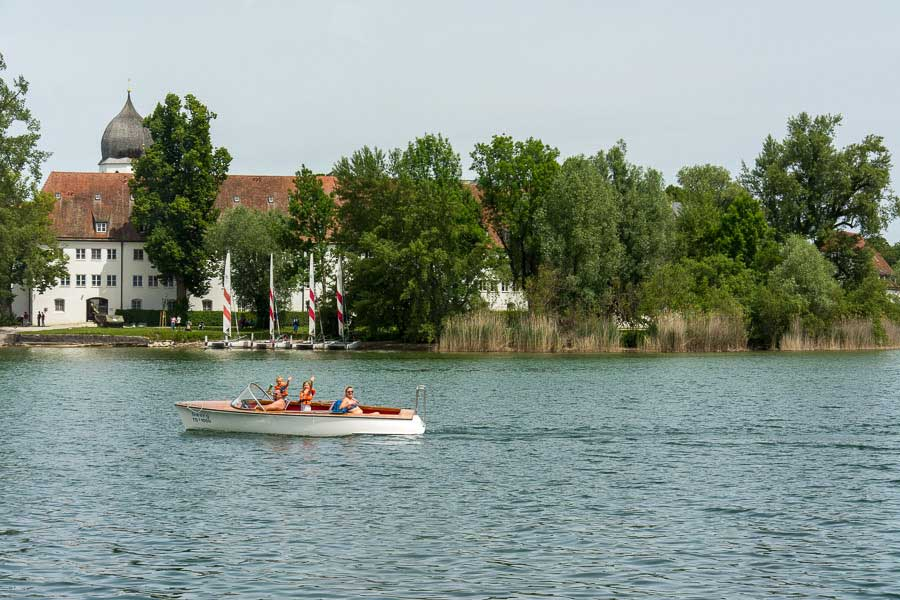 Boaters wave hello on the Chiemsee lake.