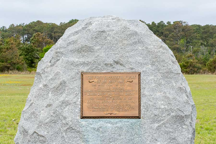 "A stone marks the ""first successful flight of an airplane"" in Kitty Hawk, North Carolina."