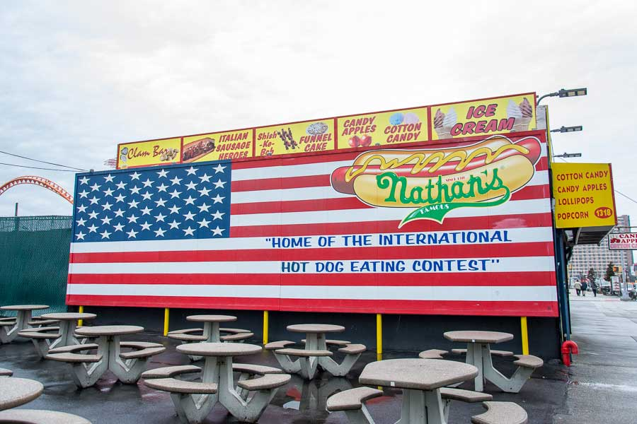 A billboard celebrates the international hot dog eating contest at Nathan's Famous original shop in Coney Island, NYC.
