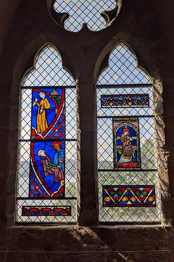 Stained glass windows in the Met Cloisters offer stunning views over the Hudson River.