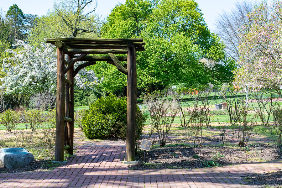 A trellis on a walkway at Hershey Gardens.