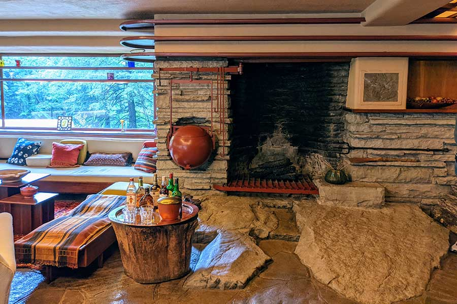 A fireplace emerges from the stones at Fallingwater.