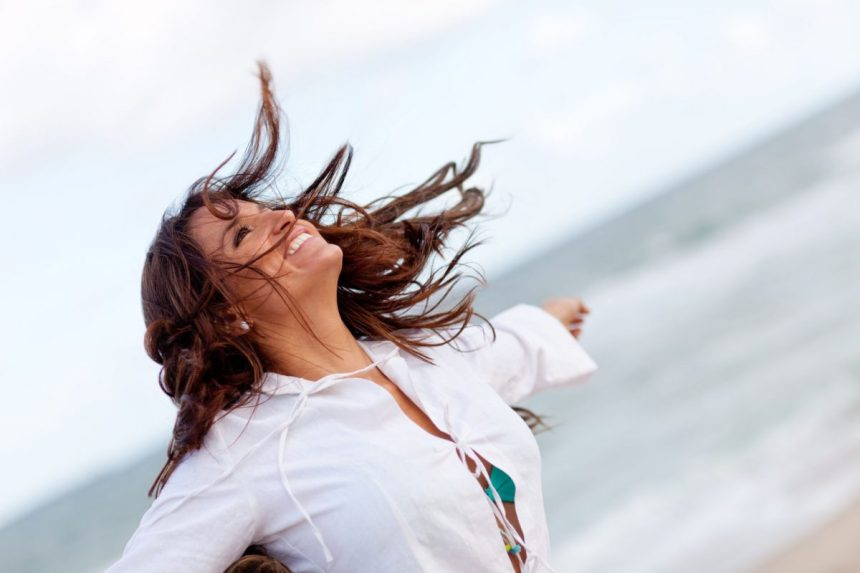 happy woman with open arms looking into the sky illustration