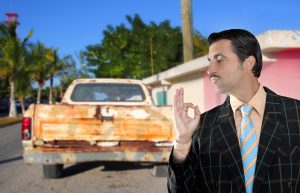 car used salesperson selling old car as brand new truck salesman