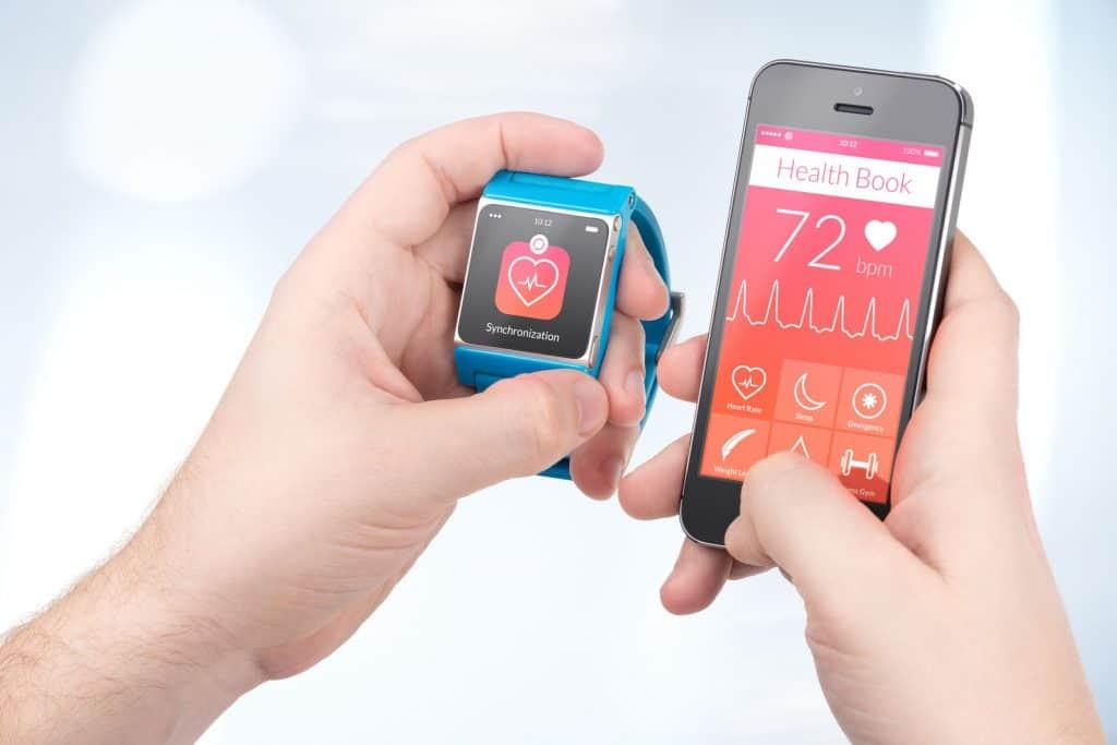 Smartphone with blue bracelet.
