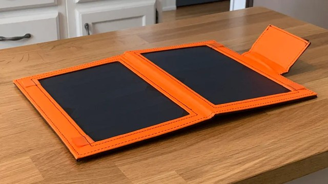 IClever solar charger, open on a wooden table