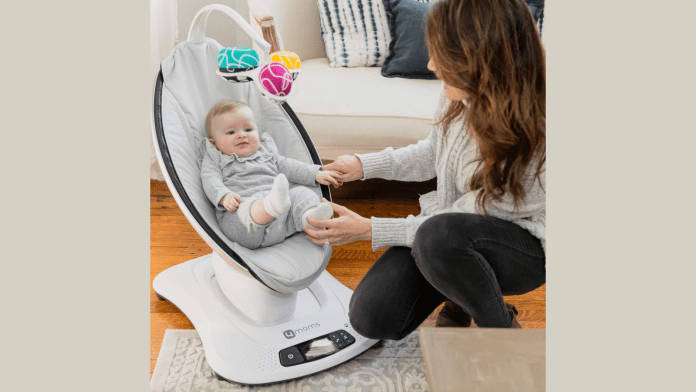 mamaRoo Smart Baby Swing by 4moms with baby and watchful mother in living room