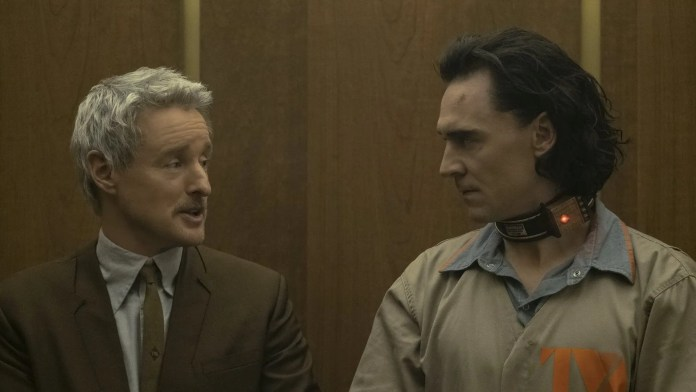 Loki and Mobius talking on an elevator.