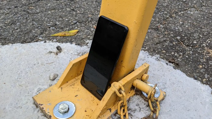 ZTE Axon 30 5G leaned against yellow pole