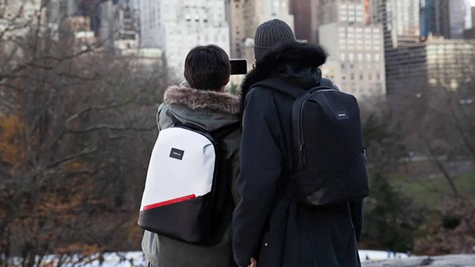 Two people wearing Urban Traveler backpacks.