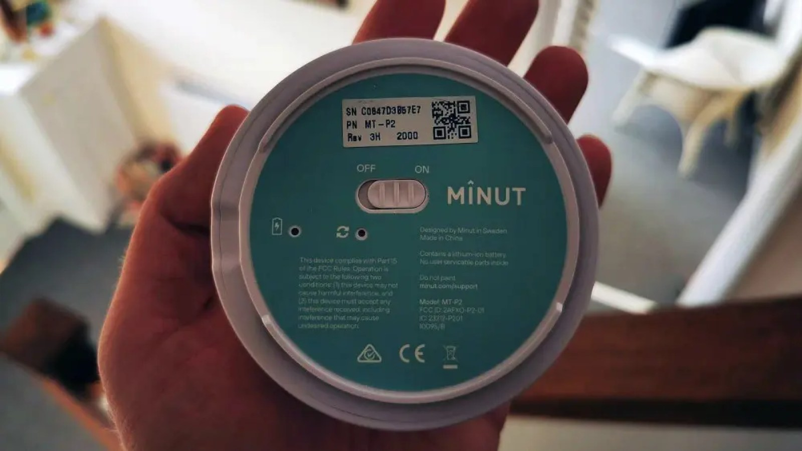 Minut controls and label on underside of device