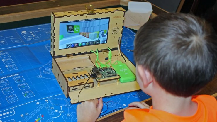 A young boy playing Minecraft on a Piper Computer kit.