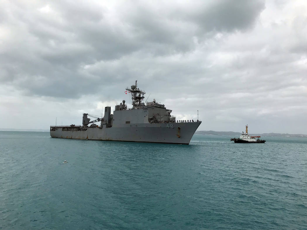 USS Ashland, carrying two women who were rescued after months at sea on their storm-damaged sailboat, arrives at White Beach Naval Facility in Okinawa, Japan Monday, Oct. 30, 2017. The U.S. Navy s ...