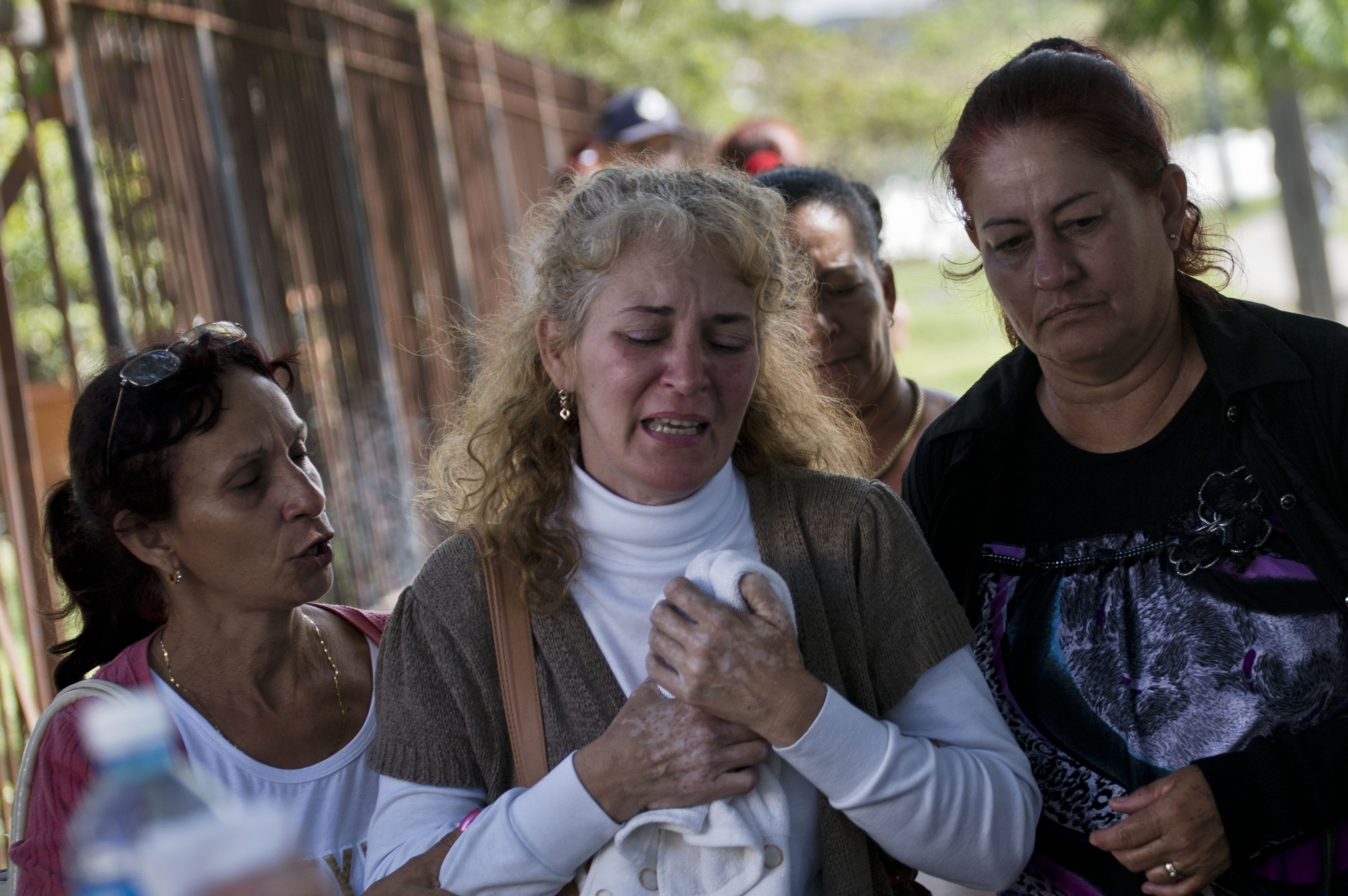 """There's still a death warrant out for me."""". Cubans mourn family, friends who died in plane crash 