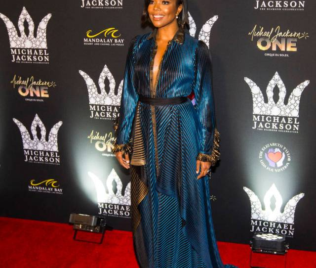 Gabrielle Union Poses On The Red Carpet Ahead Of The Michael Jackson 60th Birthday Celebration At