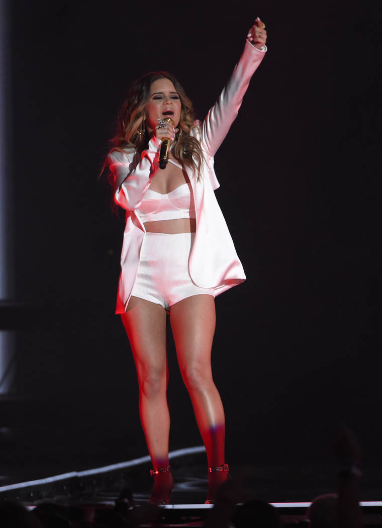 """FILE - In this May 20, 2018 file photo, Maren Morris performs """"The Middle"""" at the Billboard Music Awards at the MGM Grand Garden Arena in Las Vegas. A list of nominees in the top categor ..."""
