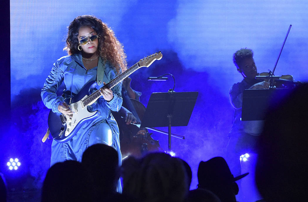 FILE - In this June 24, 2018 file photo, H.E.R. performs at the BET Awards at the Microsoft Theater in Los Angeles. A list of nominees in the top categories at the 2019 Grammys, including Kendrick ...