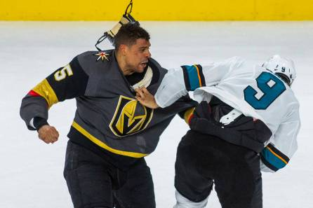 Vegas Golden Knights forward Ryan Reaves in a fight against San Jose Sharks forward Evander Kane.