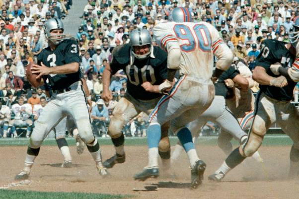 Oakland Raiders quarterback Daryle Lamonica is shown in a game against the Houston Oilers in 19 ...