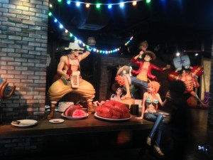 The Strawhats celebrating around a table - Nam