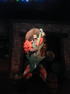 Figurine of Brook playing his guitar